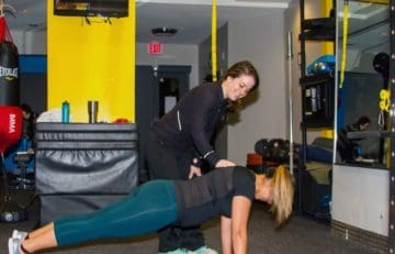 Trainer with client Plank
