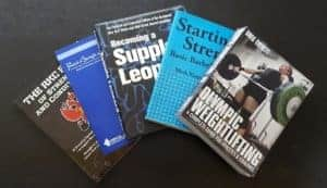 Personal Trainer Books and Certifications including CrossFit, Physical Therapy, Mobility, and Flexibility
