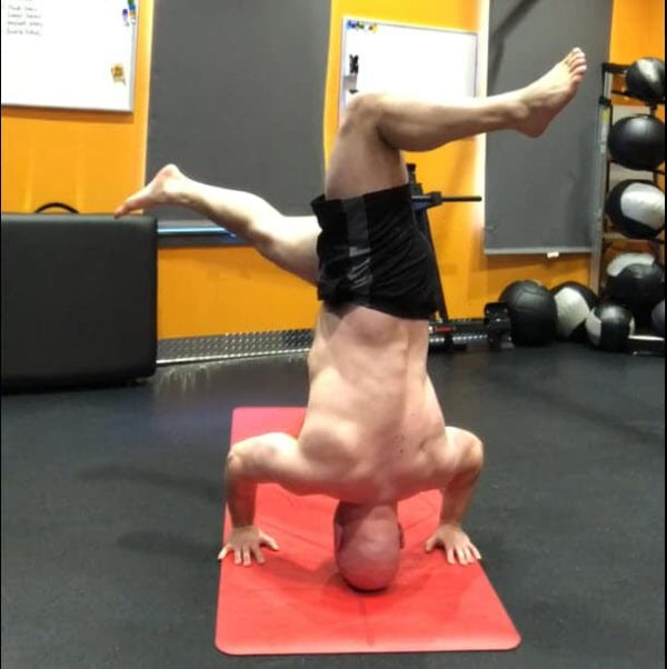 Yoga Revolved HeadStand Pose